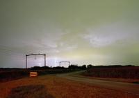 Thunder clouds and lightning near railway track in dutch countryside 11015246941| 写真素材・ストックフォト・画像・イラスト素材|アマナイメージズ