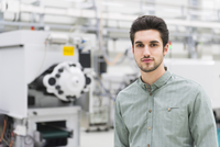 Portrait of male worker at tool manufacturing plant