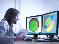 Scientist checking test map of silicon wafer in laboratory