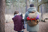 Young couple hiking together in forest