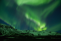 Aurora borealis above Vatnajokull glacier at night, South East Iceland
