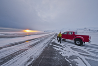 Man with off road vehicle parked on highway 1, Skaftafell, South East Iceland