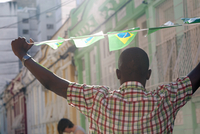 Students celebrating with Brazilian flags in the street, Rio de Janeiro, Brazil