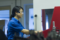 Young woman working in industrial workshop