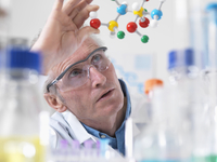 Scientist viewing molecular model of a chemical formula in a laboratory
