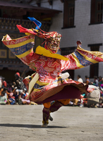 Masked performer dancing at festival, Punakha, Bhutan