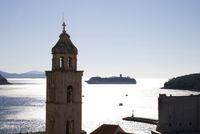 Silhouetted view of church tower and distant cruise ship, Dubrovnik, Croatia