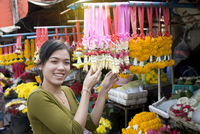 Portrait of young female market stall holder, Bangkok, Thailand