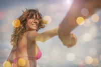 Mid adult woman wearing bikini top