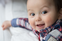 Portrait of baby boy, looking at camera, smiling
