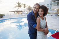 Stylish couple hugging at hotel poolside, Rio De Janeiro, Brazil