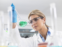 Scientist viewing chemical experiment in a laboratory