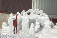 Woman touching ice sculpture