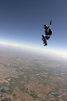 Freeflying skydiver in blue sky