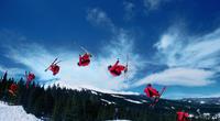 Mature man, skiing, freestyle, in jump, multiple exposure