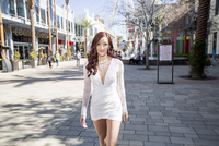 Fashionable young woman strolling on street, Las Vegas, Nevada, USA