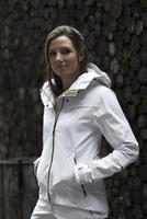 Mid adult woman wearing white coat, portrait