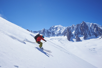 Male skier speeding downhill,  Mont Blanc massif, Graian Alps, France