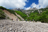 Five mature hikers hiking in valley, Grigna, Lecco, Lombardy, Italy