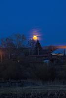 Rural scene with moon shining above trees, Sarsy village, Sverdlovsk region, Russia 11015256248| 写真素材・ストックフォト・画像・イラスト素材|アマナイメージズ