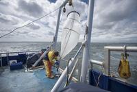 Scientist preparing plankton net on research ship