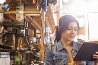 Female mechanic using digital tablet in workshop