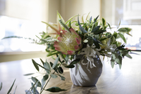 Flower arrangement with foliage on dining room table