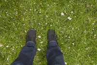 High angle view of young womans feet on lawn