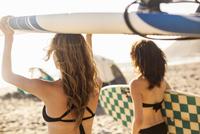 Girlfriends going surfing