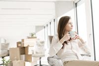 Businesswoman taking a coffee break in new office