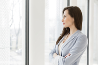 Businesswoman watching out of office window