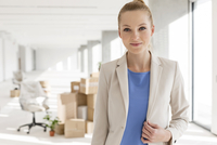 Portrait of young businesswoman in new office