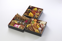 Assortment of foods in bento boxes, studio shot