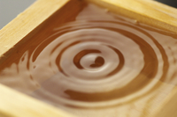 Abstract concentric circles in liquid, close up