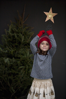 Portrait of a girl holding a christmas decoration