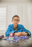 Boy working on science project at home, frustrated expression