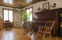 Rocking chairs and piano in the living room of house