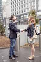 Business people shaking hands, New York, USA