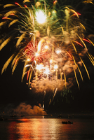 Fireworks exploding over water, Bainbridge Island, Washington, USA