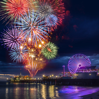 Multicolored firework display in night sky on waterfront, Los Angeles, California, USA