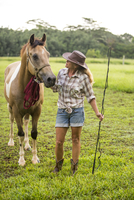 Portrait of mature woman standing beside horse