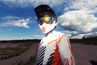 Portrait of young man in motocross clothing