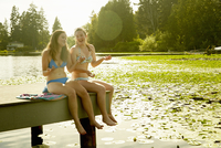 Girls in bikini enjoying lake, Seattle, Washington, USA