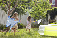 Girls in butterfly costumes playing in garden