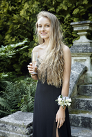 Teenage girl wearing prom dress and corsage holding champagne flute looking at camera smiling 11015264147| 写真素材・ストックフォト・画像・イラスト素材|アマナイメージズ