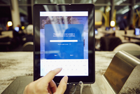 Womans hand using digital tablet touchscreen for restaurant  payment