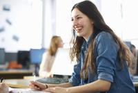 Smiling female student having classroom tutorial