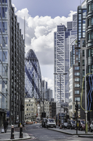 View of city street and Gherkin building, London, England, UK