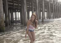 Portrait of young woman having fun in sea, Santa Monica, California, USA