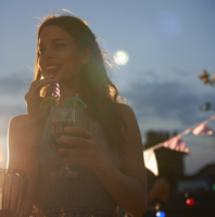 Woman at early evening party